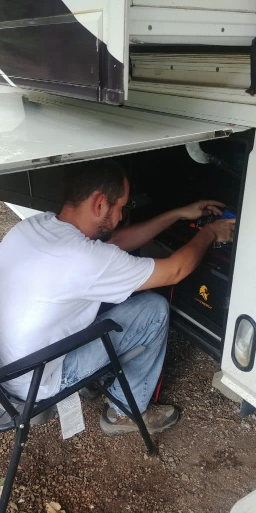 kevin working in battery bay of  motorhome on RV solar installation