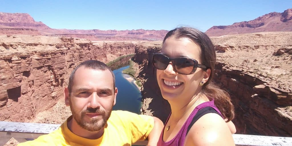 kevin and kara posing on navajo bridge 470 feet above the colorado river