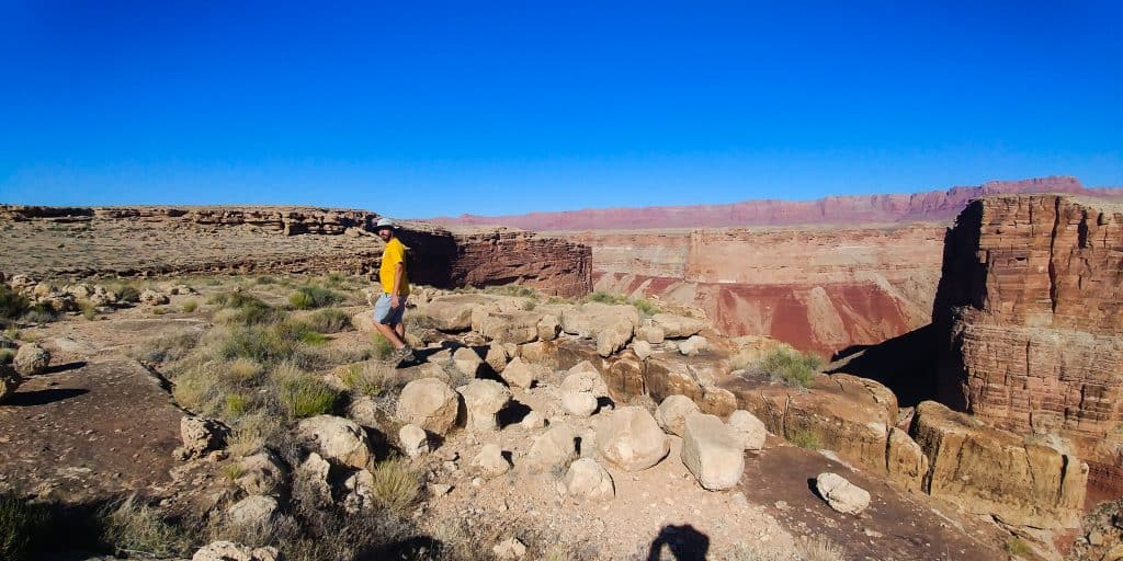 kevin hiking around our free campsite on the vermillion cliffs during our 2-days in page arizona