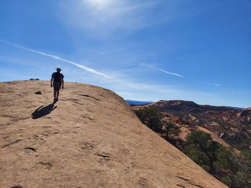 kevin leading the way at whale rock canyonlands national park
