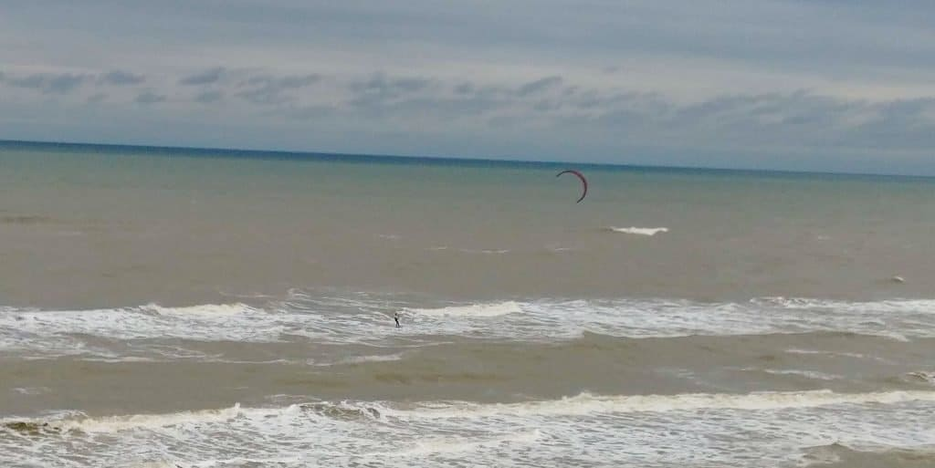 wind surfer giving a show to winter texans staying in oceanfront condos