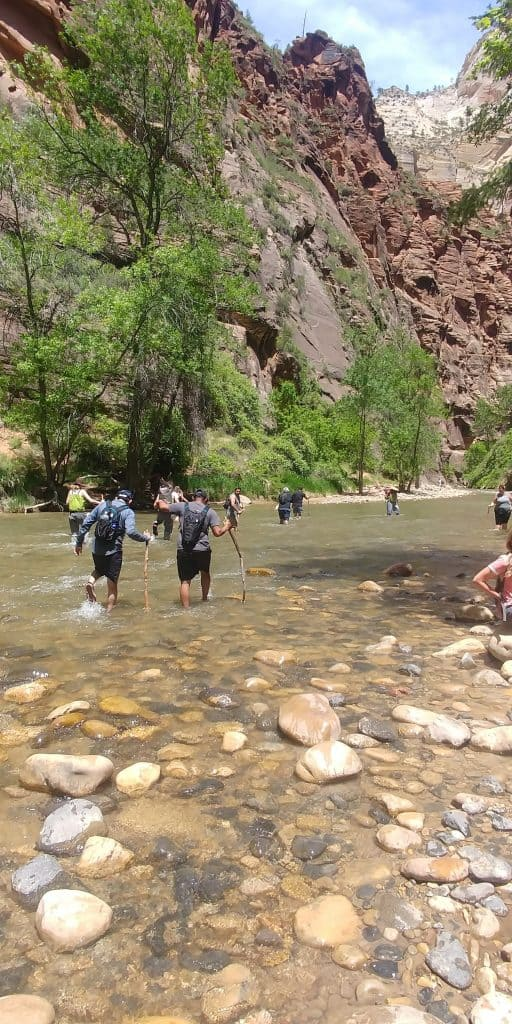 hikers at the narrows in zion