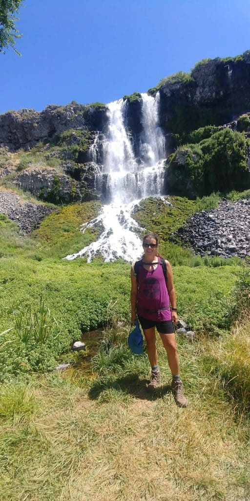 kara in front of falls on ritter island