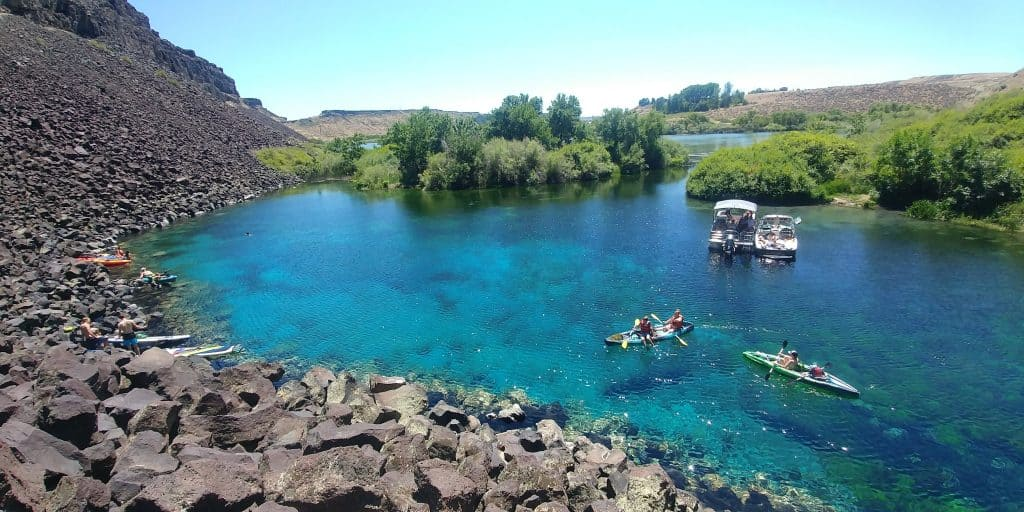 blue heart springs in idaho with boats