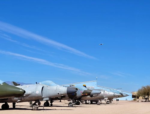 air force plane flying over pima air and space museum