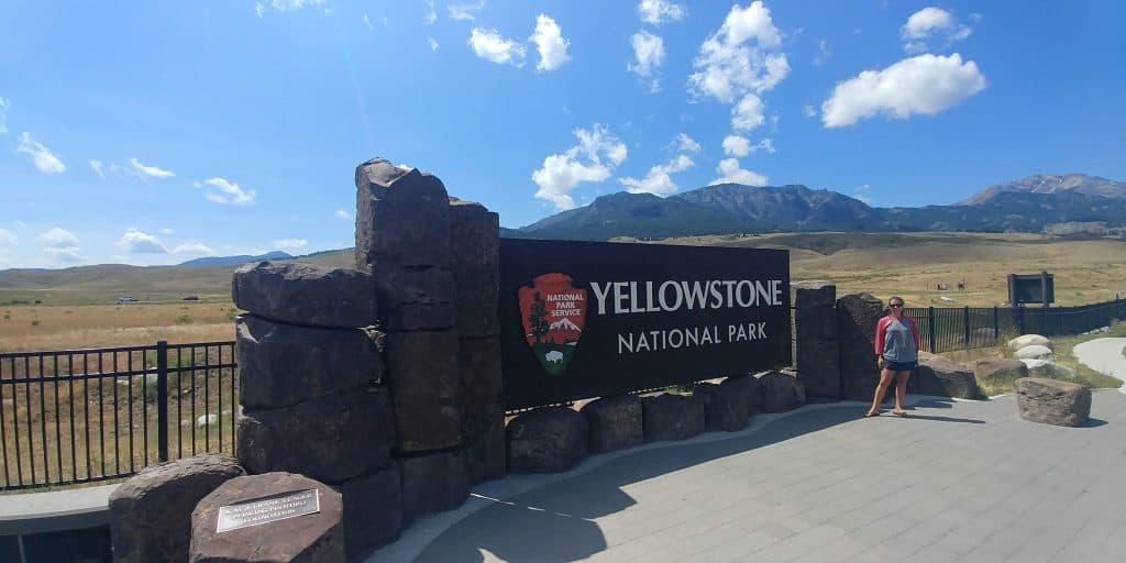 kara at north yellowstone entrance sign