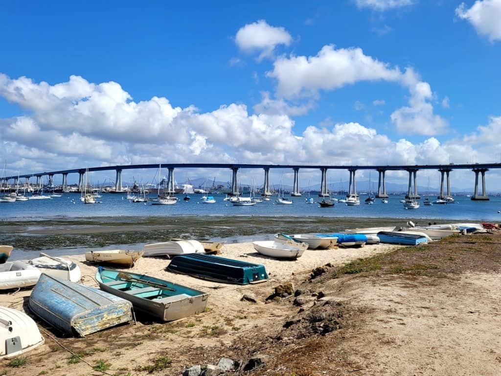 sailboat dingy parking on coronado under bridge to san diego