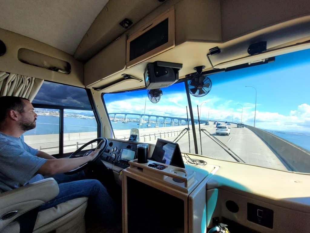 kevin driving pippi over coronado san diego bridge