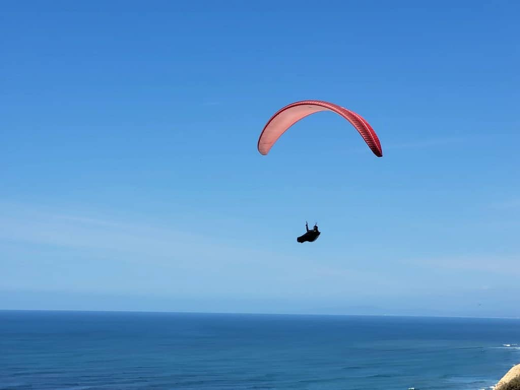 paraglider with feet in bag at torrey pines gliderport