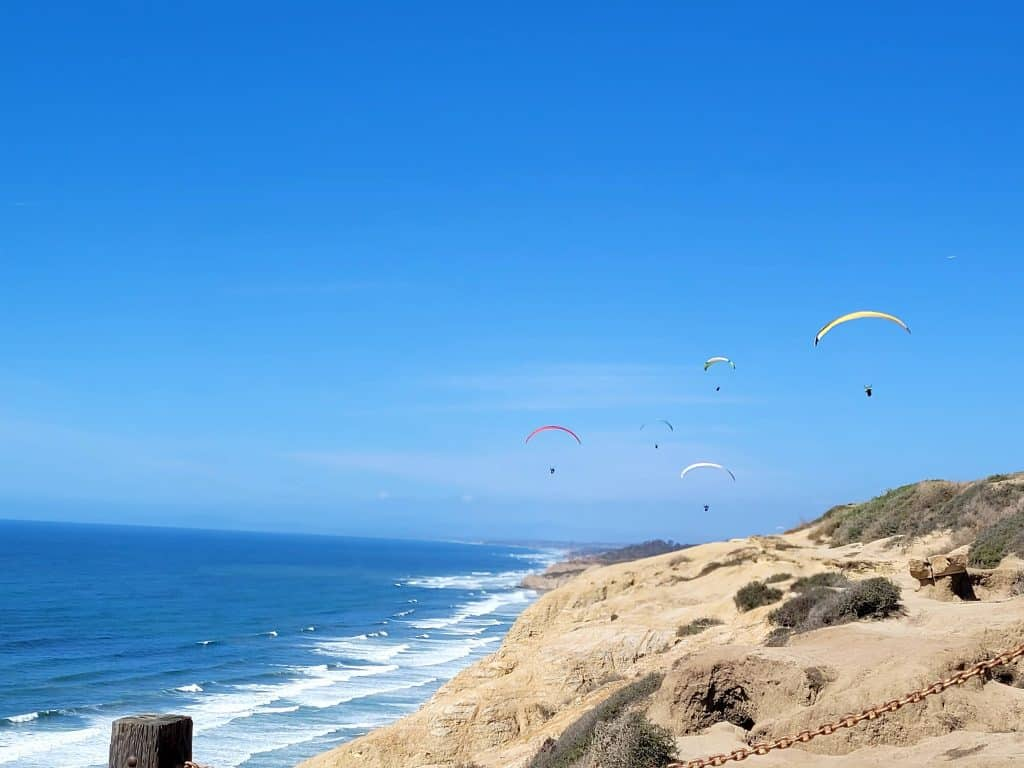 paragliders in the distance at torrey pines gliderport