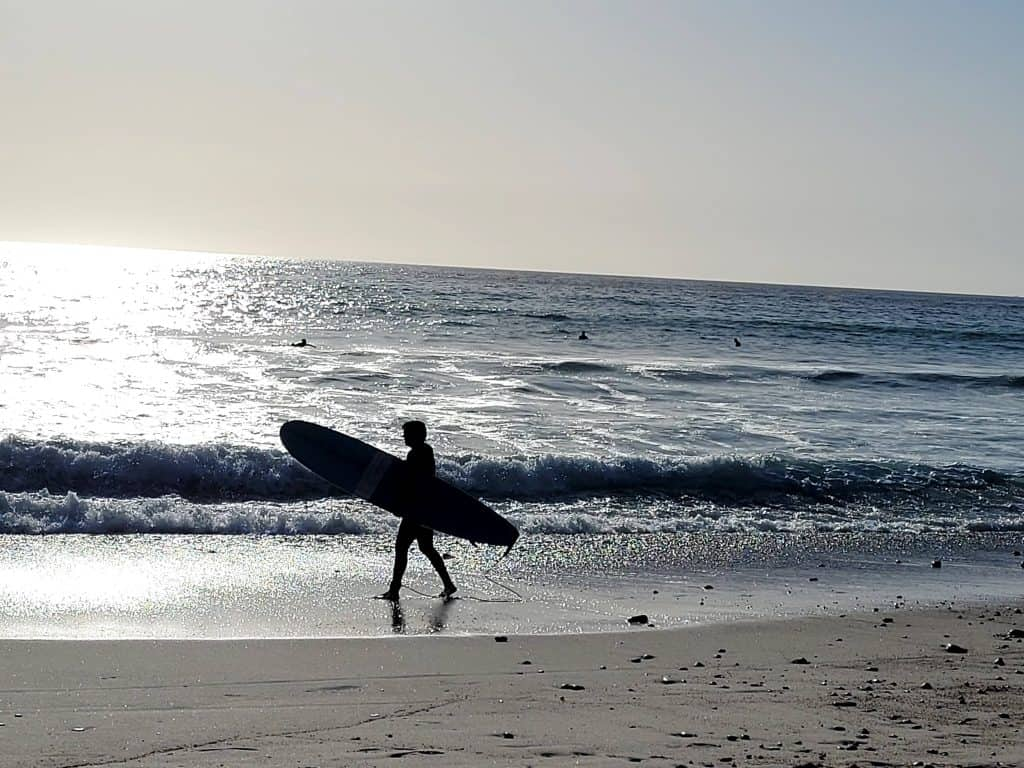 surfer on southern california beach in san clemente