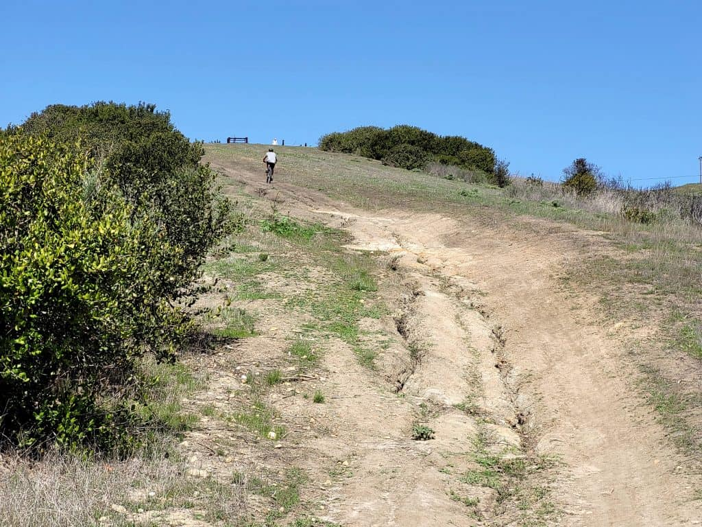 kevin climbing the trestles community connector trail on his mountain bike in san clemente california