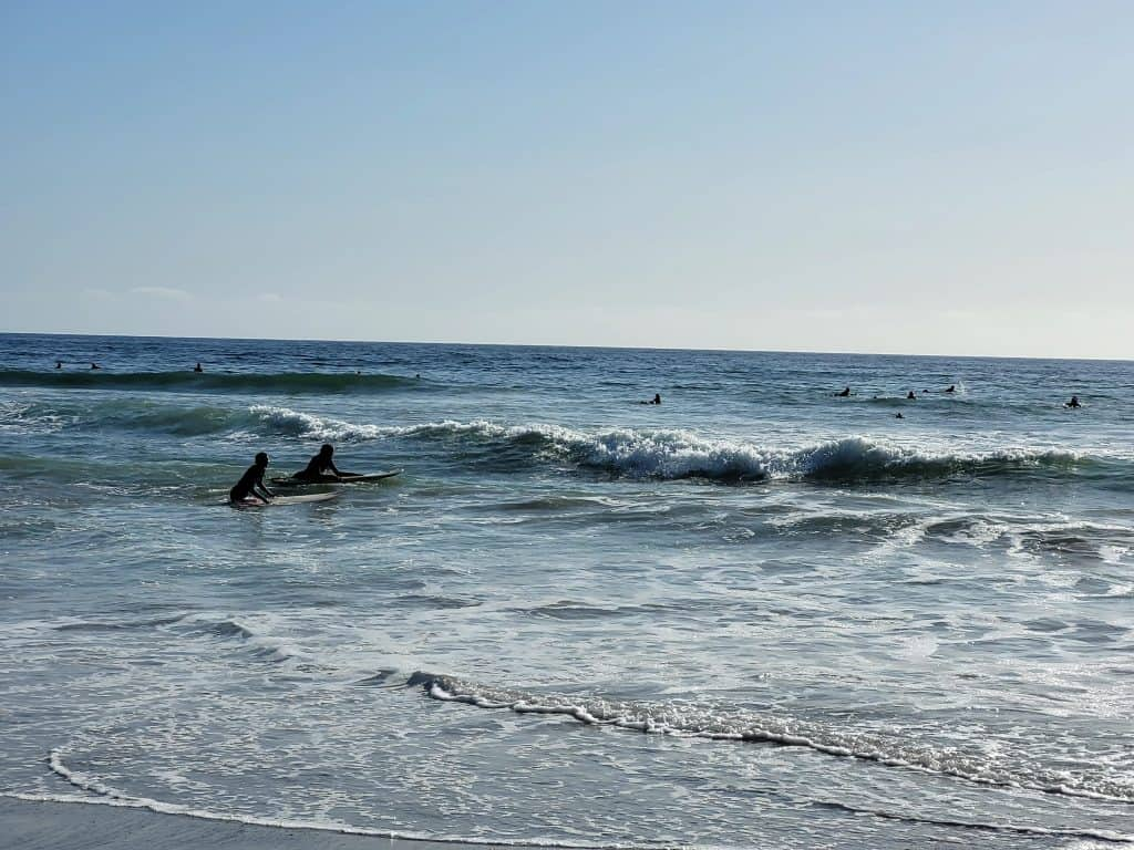 surfers in front of san clemente surf school