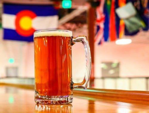 colorado flag behind a pint of beer