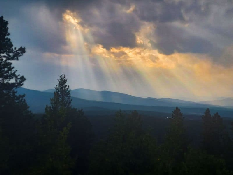 sun rays through clouds at panorama point