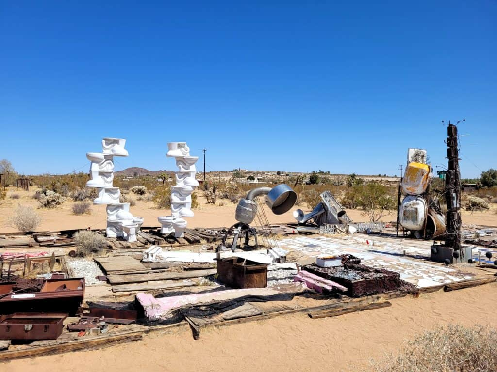 expect to spot a recognize household items in the sculptures at the noah purifoy outdoor desert art museum