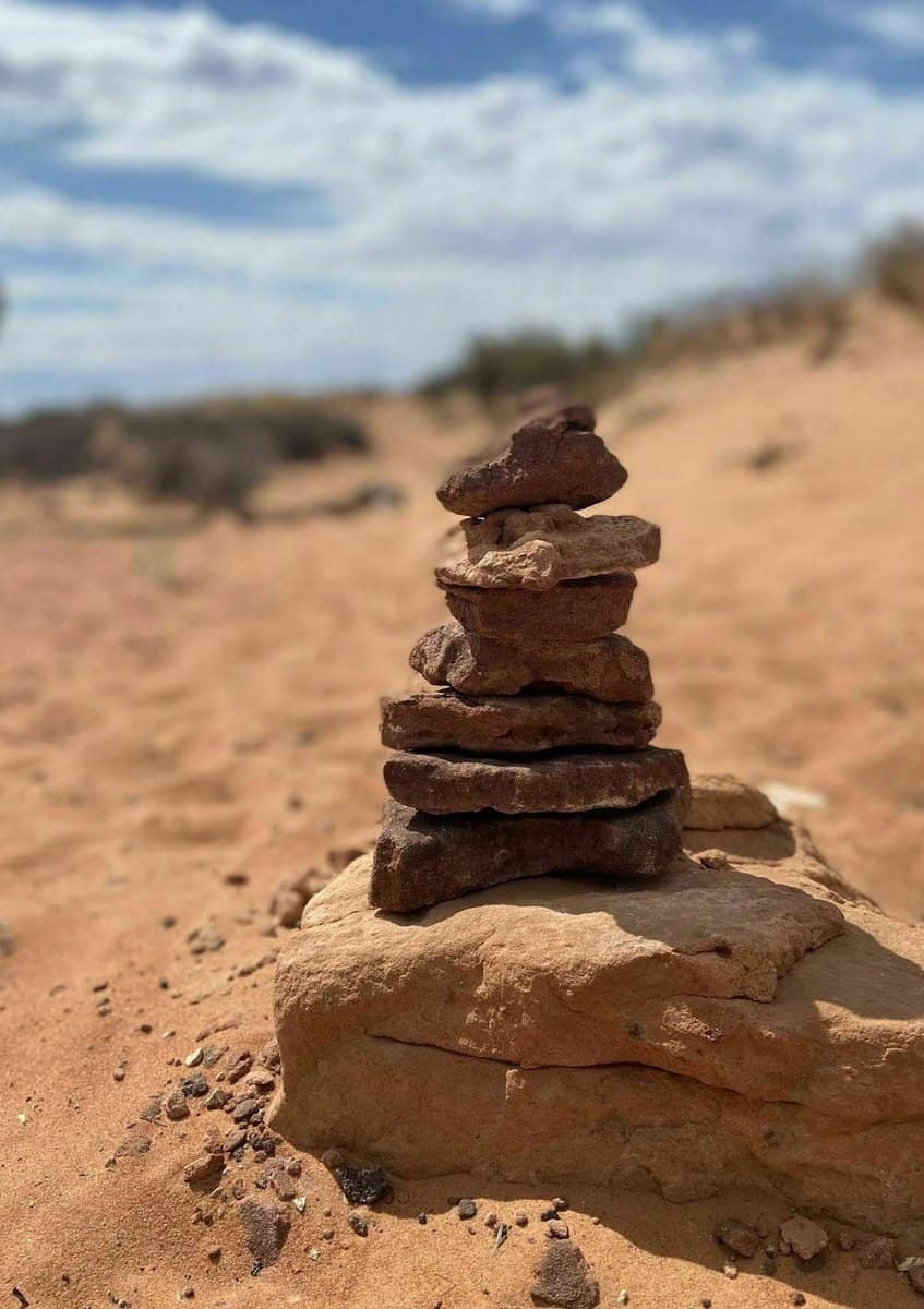 rock cairns lead the way between slot canyons