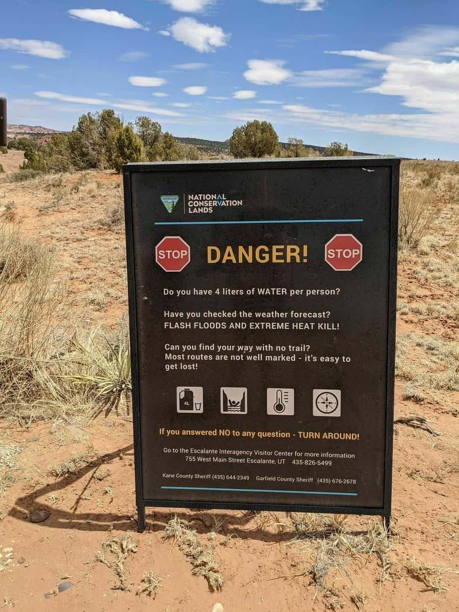 escalante slot canyon hiking trail warning sign