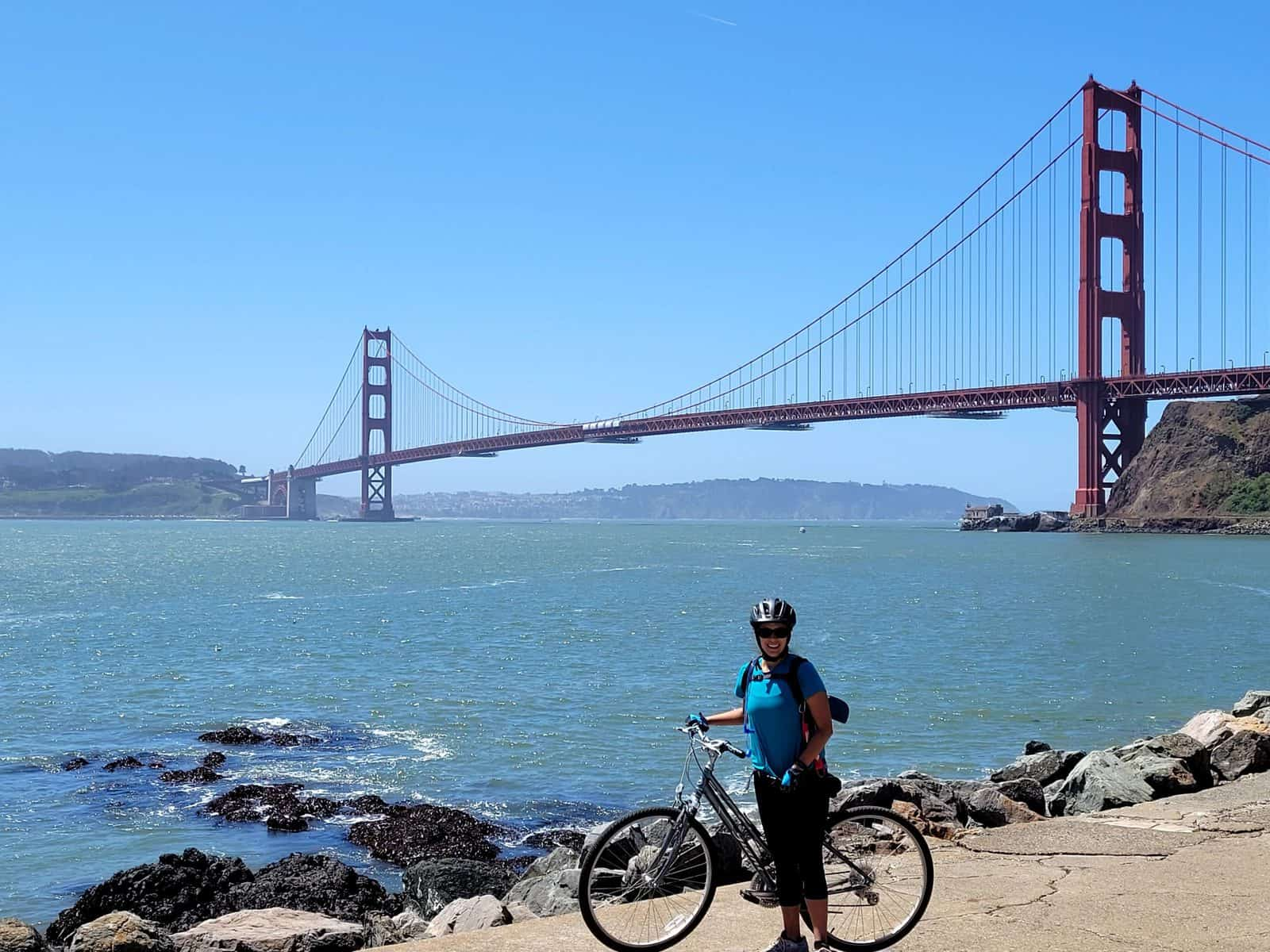 kara enjoying Golden Gate bridge views near battery yates in san Francisco