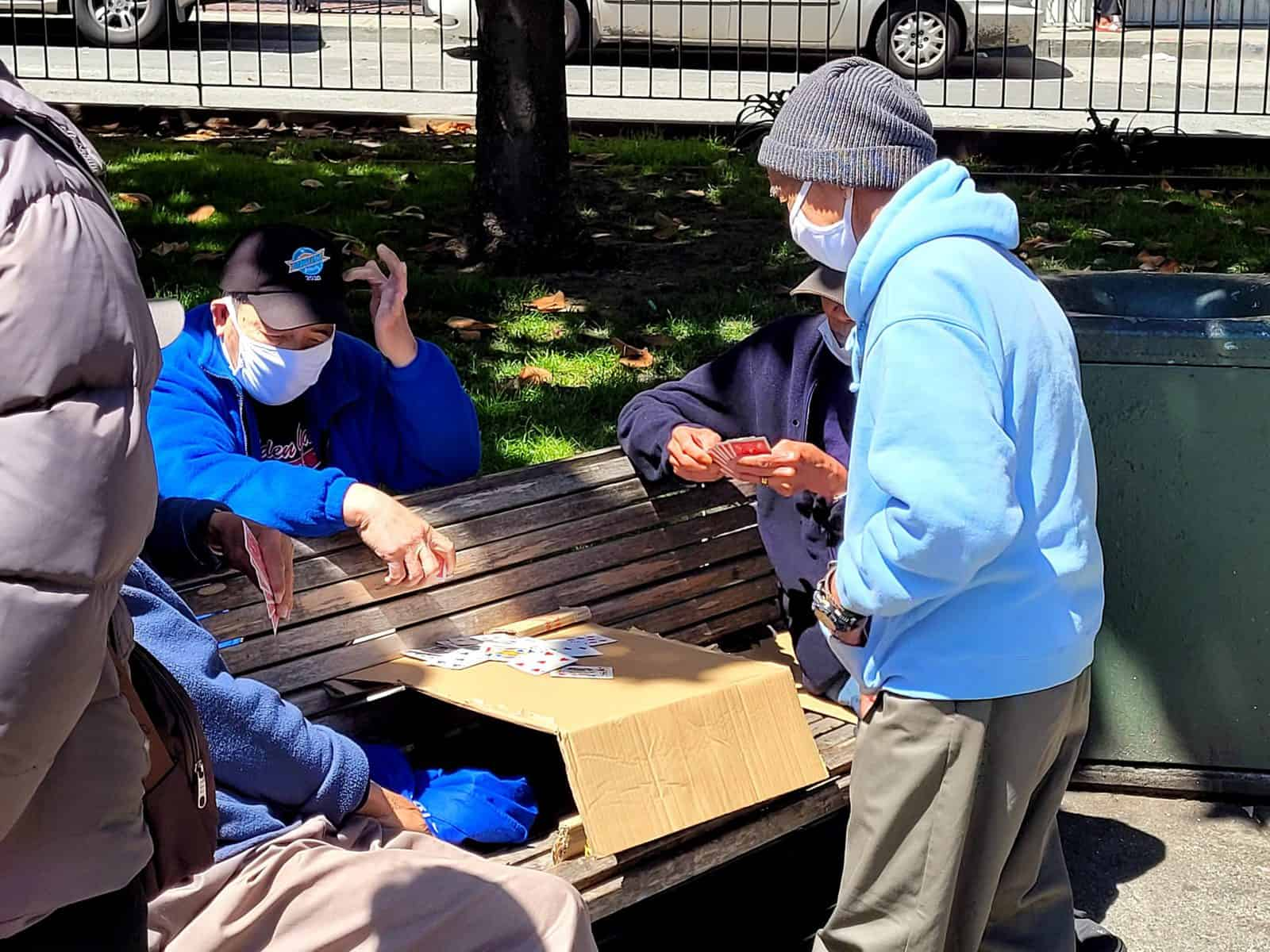 local seniors playing cards in portsmouth square in san francisco